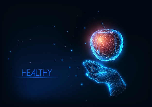 Futuristic healthy diet, nutrition concept with glowing low polygonal human hand holding colorful apple isolated on dark blue background.