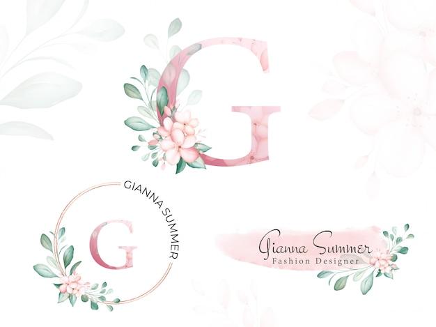 Акварельный золотой цветочный логотип для начальной буквы g из мягких цветов и листьев.