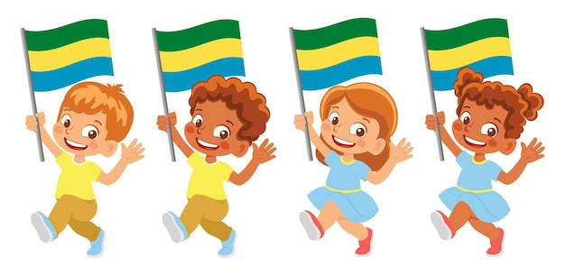 Флаг габона в руке. дети держат флаг. государственный флаг габона