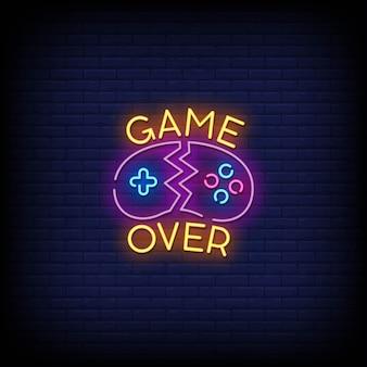 Игра окончена в стиле неоновых вывесок Premium векторы