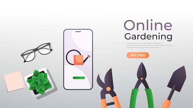 스마트 폰 화면에 정원 및 농장 도구 에코 스마트 농업 관리 온라인 원예 개념 가로 복사 공간 그림