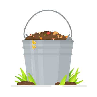 Garden composters for biodegradable  waste. bucket filled with fertile soil with worms.