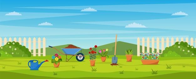Огород с зеленой травой, цветами, садовая тачка, лопата. концепция сада.