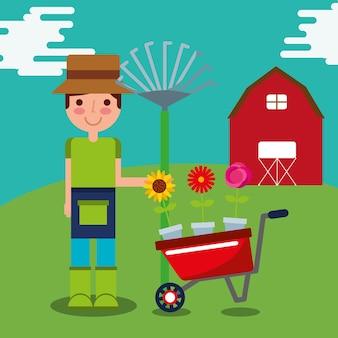 Gardener boy with wheelbarrow and pitchfork farm work