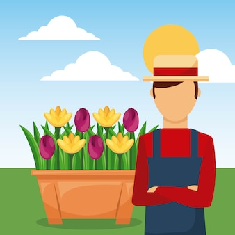 Садовник с руками, сложенными в саду цветами