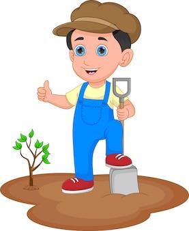 木を植える園芸少年は親指を立てる