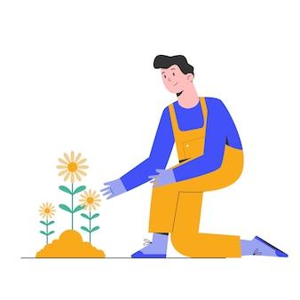 ガーデニング男は幸せで花を植える