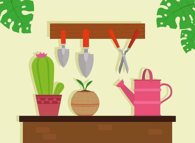 테이블에 원예 도구 및 관엽 식물