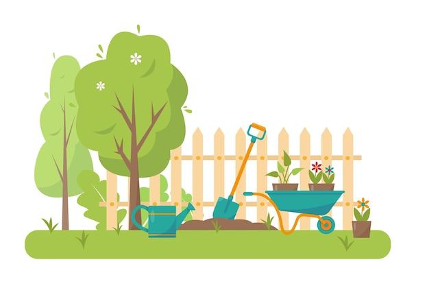 Садовые инструменты и деревья в саду.