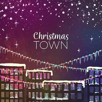 ライトgarlandsとクリスマスの町の背景