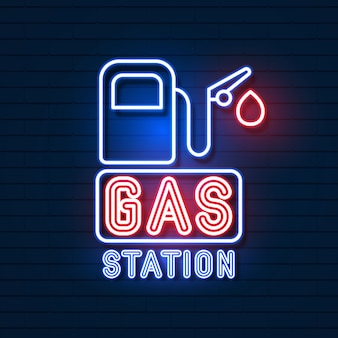 Gas station neon logo on brick wall