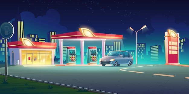 Gas station with oil pump and market at night