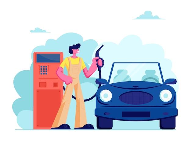 ガソリンスタンドの労働者は、車に燃料を注ぐための充填ガンを保持します
