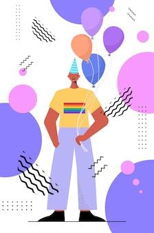 Gay in festive hat celebrating transgender love parade lgbt community concept
