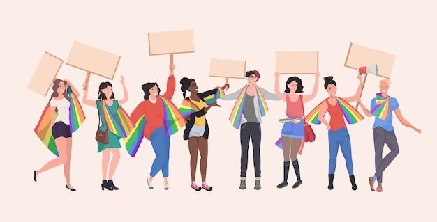Gays and lesbians with lgbt rainbow flags holding protest posters blank placards love parade pride festival demonstration concept full length horizontal