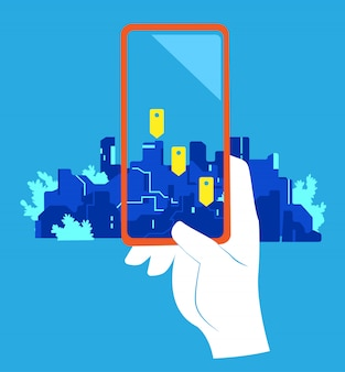 Geo location app. a hand pointing a cellphone with geo pins screen against the city