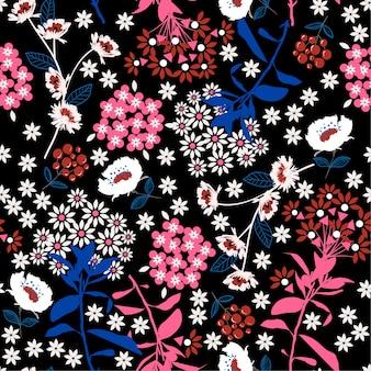 幾何学的な濃い咲く花と葉の暗闇で