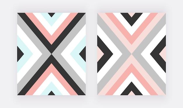 ピンク、ブルー、グレーの三角形の幾何学的なデザイン。