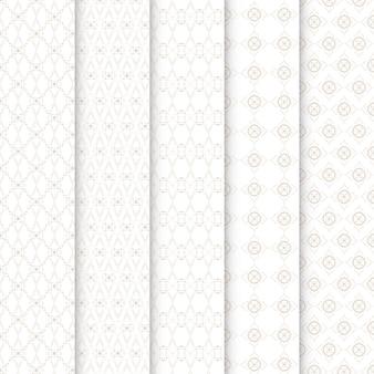 원활한 패턴 금색과 흰색의 기하학적 꽃 세트