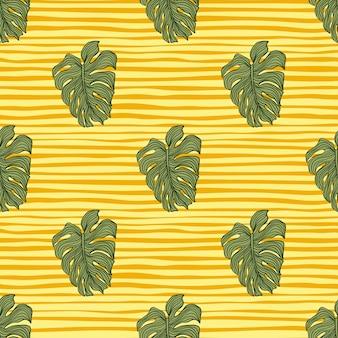 幾何学的なモンステラは、黄色の縞模様の背景にシルエットのシームレスなパターンを残します