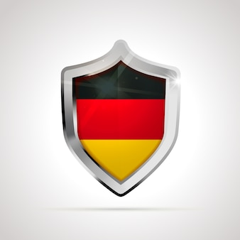 光沢のある盾として投影されたドイツの旗