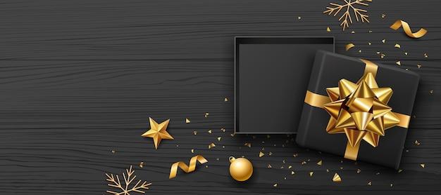 선물 상자와 금 활 리본