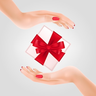 Gift box between two hands