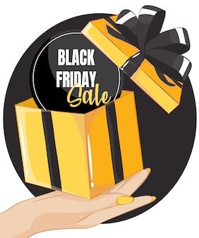 Подарочная коробка черная пятница распродажа на руке женщины