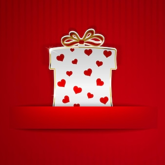 Gift box cut out of white paper with red hearts on red striped background