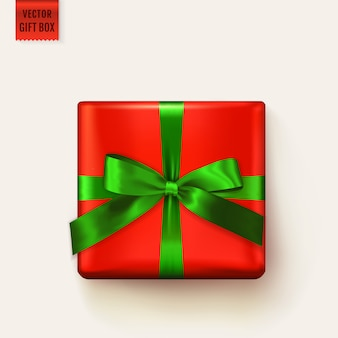 Gift box tied with ribbon. realistic isolated element for christmas design, birthday greeting card, sale banner or other decoration. red square giftbox with green bow. top view.