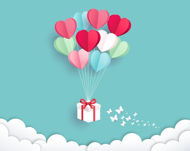 Gift box with balloon on sky paper cut style. valentines day card background.