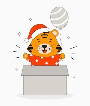Подарочная коробка с милым тигром в новогодней шапке выпрыгивает