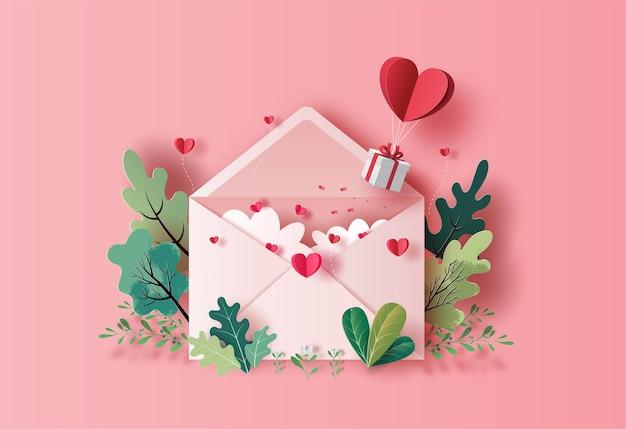 종이 그림에서 연애 편지와 함께 떠있는 하트 풍선 선물 상자