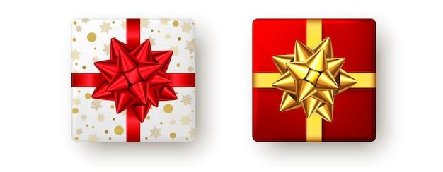 赤と金色のリボンと弓、上面図のギフトボックス。クリスマス、新年会、お誕生日おめでとうまたはバレンタインデーのパッケージデザイン。現在は白い背景で隔離。ベクター。