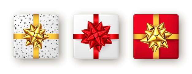 Подарочная коробка с красной и золотой лентой и бантом, вид сверху, дизайн упаковки рождественской новогодней вечеринки