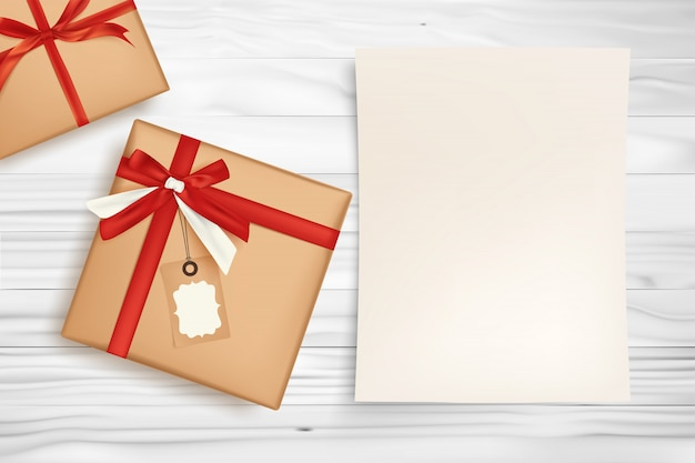 Gift box with red ribbon and white paper for holiday concept.