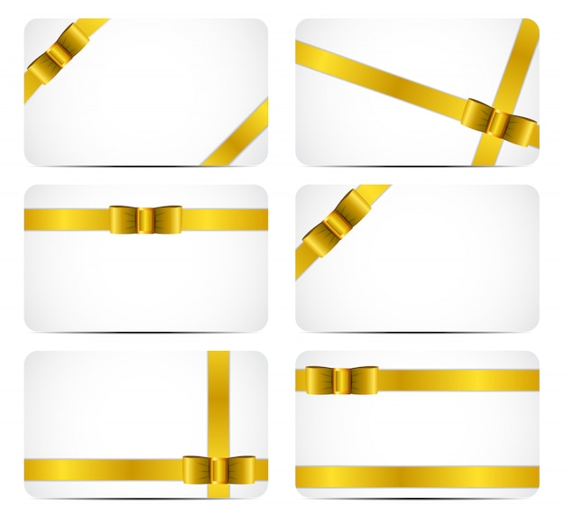 Gift card set with gold ribbon and bow.