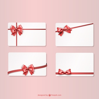 Gift cards with red ribbons
