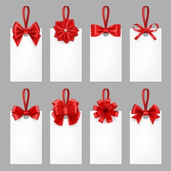 Gift cards with ribbons. tags with textile bow from elegant silk ribbon for present  realistic template