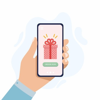 Gift online shopping concept ordering gifts online from home huge present box in smartphone screen
