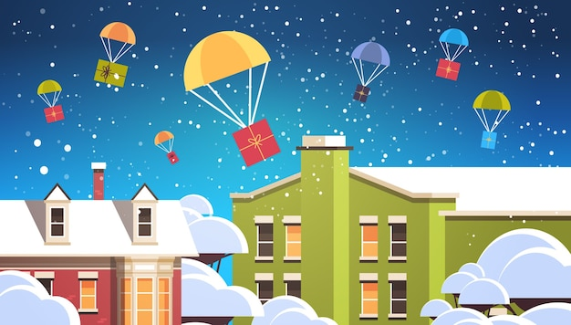 Gift present boxes falling down with parachutes merry christmas happy new year air mail express delivery concept winter city houses snowy town street horizontal vector illustration