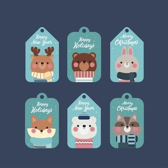 Подарочные бирки или этикетки с милыми персонажами животных и надписями. с рождеством