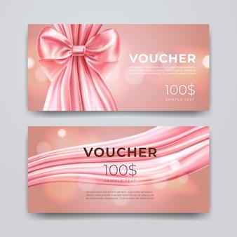 ギフト券のデザインテンプレート。ボケ味の背景に分離されたリアルなピンクの弓とシルクのプレミアムプロモーションカードのセットです。割引券、クーポンまたはリーフレット。
