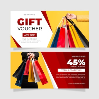 Gift voucher template with shopping bags photo