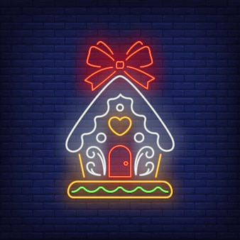 Gingerbread house with red bow in neon style