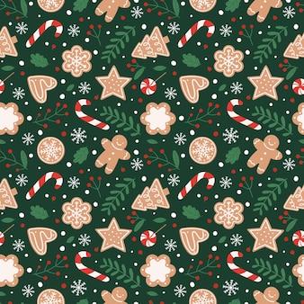 ジンジャーブレッドのシームレスなパターン。クッキー、キャンディー、葉、ベリーとお祭りの背景。緑の背景にフラット漫画スタイルのベクトル図