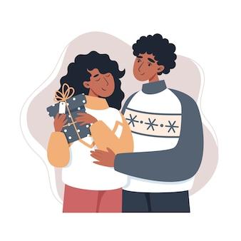 贈り物を持っている女の子と男の子