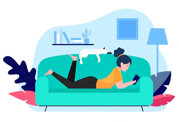 少女と猫がソファーでリラックス