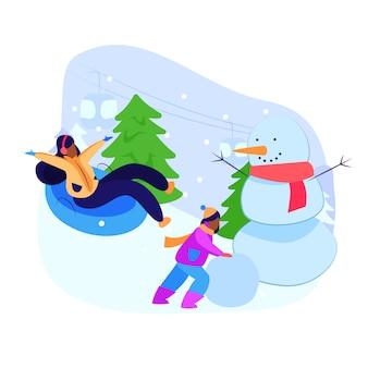 冬のアクティビティを楽しんでいる少女と母親