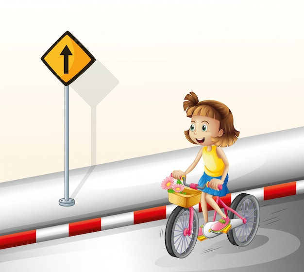 A girl biking at the road